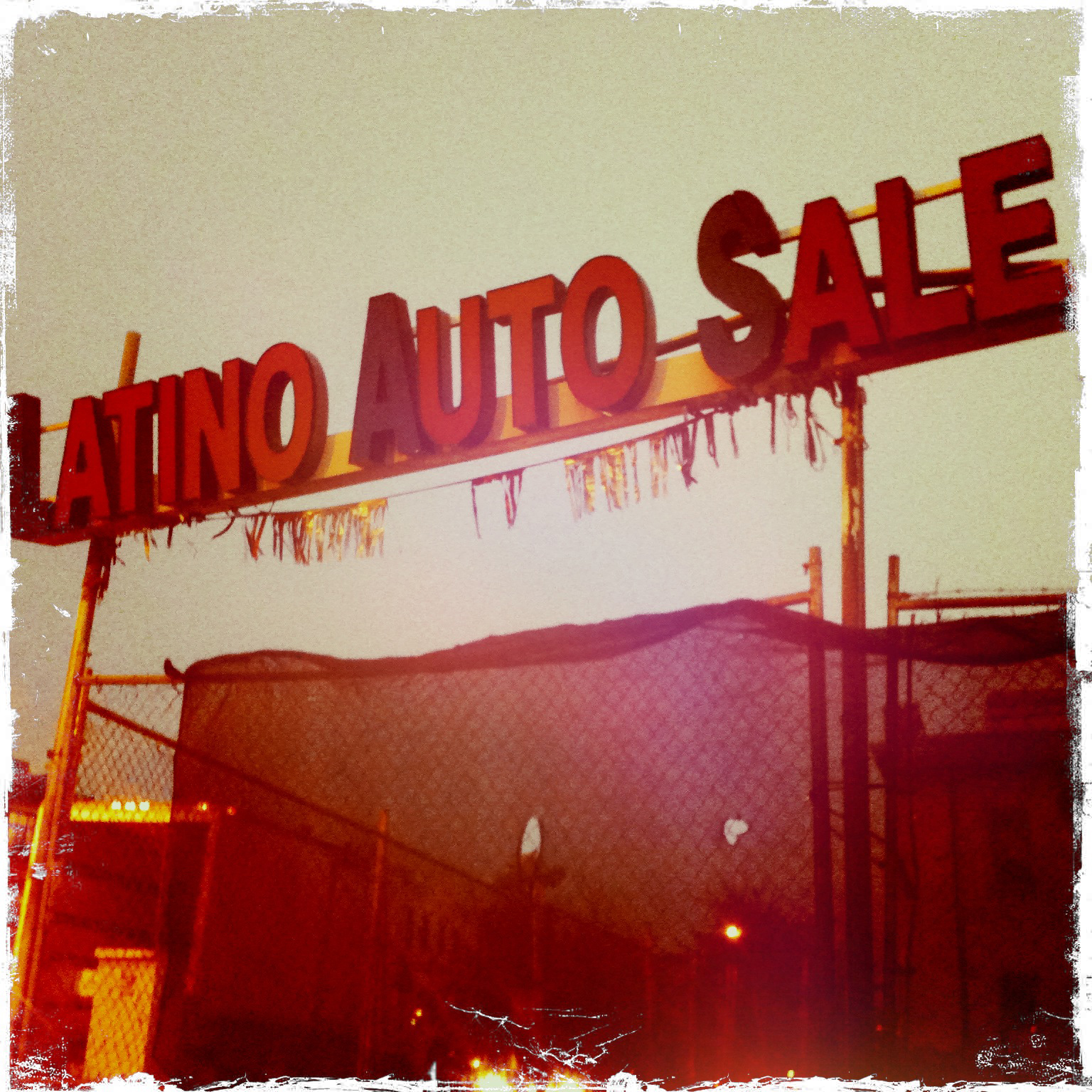 Latino Auto Sales sign